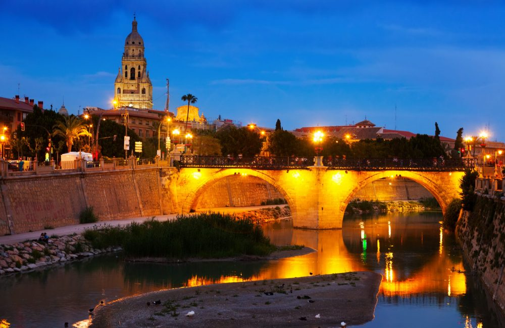 Old bridge over Segura river in evening. Murcia, Spain